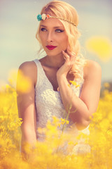Beautiful blonde woman in yellow field