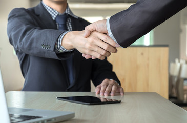 Business partnership meeting concept. Images of business people shaking hands while greeting at the working place. businessmen handshaking after good deal success