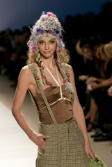 A model poses on the runway wearing clothing by designer Kara Janx at the Project Runway Fall 2006 in New York
