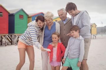 Happy multi-generation family taking selfie