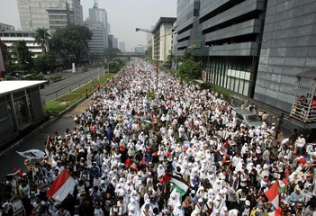 Indonesian Muslims from the Muslim-based Prosperous Justice Party attend an anti-Israel rally in ...