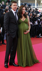 "Actors Angelina Jolie and Brad Pitt arrive for the screening of the animated film ""Kung Fu Panda"" in Cannes"