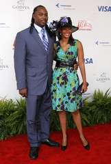 Former heavyweight champion Lennox Lewis and his wife Violet Chang arrive for the 134th running of the Kentucky Derby horse race at Churchill Downs in Louisville