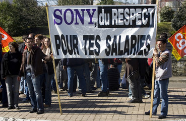 Workers of Pontonx-sur-l'Adour Sony plant wait outside the subprefecture building in Dax