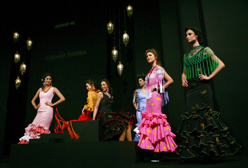 Models present creations from Carmen Piedra during the International Flamenco Fashion Show in Sevill..