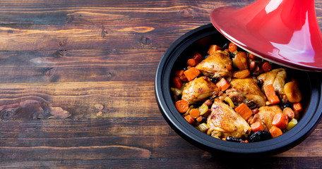 Tagine with cooked chicken, vegetables. Copy space
