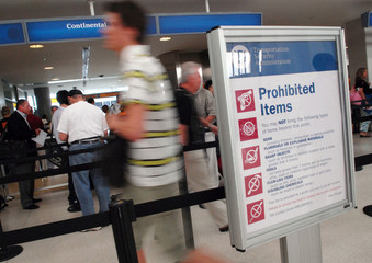Passengers walk into the Continental Airlines security checkpoint at Newark Liberty International Airport in Newark