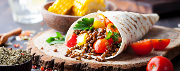 Vegan tortilla wrap, roll with lentil and corn.