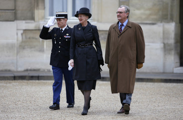 Denmark's Queen Margrethe II and Prince Henrik arrive for a meeting with France's President Nicolas Sarkozy at the Elysee Palace in Paris