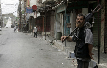 A militant of the Fatah al-Islam stands in the street in the Palestinian Nahr al-Bared refugee camp in northern Lebanon