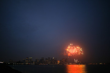 Fireworks light up the sky with Manhattan in the background in New York