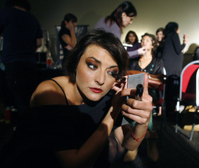 """A model applies make up backstage before a fashion show showcasing a new collection of Argentine designer Roberto Piazza named """"Diosas"""" (Goddess) in Buenos Aires"""