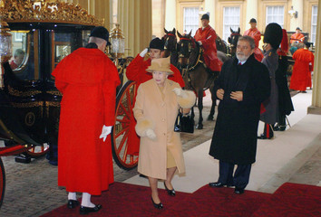Britain's Queen Elizabeth II arrives with the President of Brazil Lula da Silva at Buckingham Palace in London
