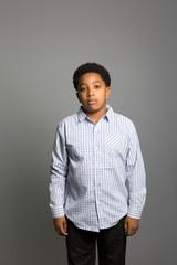 studio portrait of a pensive boy
