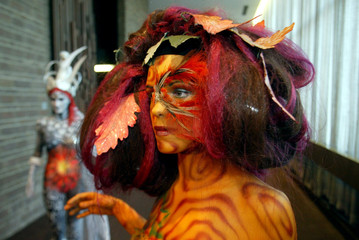 "-PHOTO TAKEN 15MAR03- A model, painted by Dutch artist Loes Mehlbaum and called ""Living tree"", poses.."