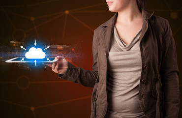 Woman holding tablet with cloud icon