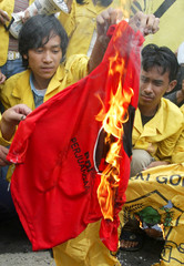 INDONESIAN STUDENT PROTESTERS SET A POLITICAL PARTY SYMBOL ON FIRE IN JAKARTA.