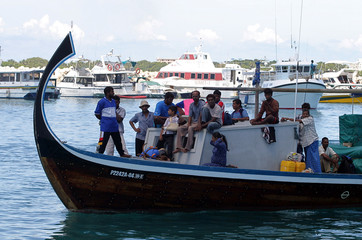 Maldivians arrive on main island on boat in Male.