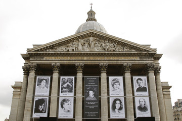 Portraits of historic French women hang from the Pantheon in Paris