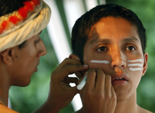 Dancers from Peru's Jallmay dance company apply make-up during Ciudad de Burgos festival in Burgos in northern Spain