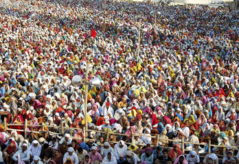 A crowd of followers gather to get the blessings of Baba Jai Gurudev in Mathura