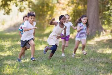 Playful children running at campsite