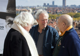 U.S. actor Clint Eastwood chats with film critic Pierre Rissient and French director Bertrand Tavernier on the last day of the Lumiere 2009 Grand Lyon Film festival in Lyon