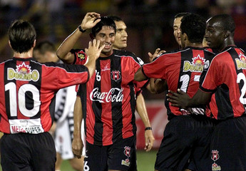 COSTA RICAN PLAYERS FROM LAJUELENSE CELEBRATE A GOAL AGAINST PANAMASARABE UNIDO.