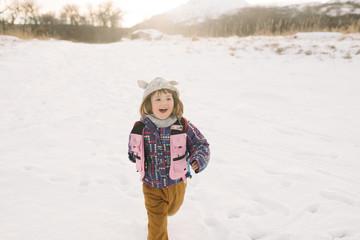 Girl running in snow