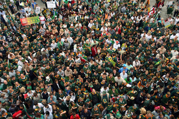 Fans wait for the arrival of the Springbok rugby team at the O.R Tambo airport in Johannesburg after winning the Rugby World Cup