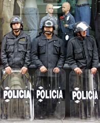 PERUVIAN POLICE MEN STANDING GUARD IN DOWNTOWN LIMA.
