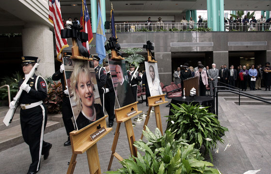 Memorial service for court employees killed by suspect Nichols in Atlanta.
