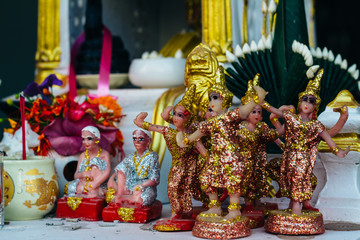 The Buddhist religious statues - souvenirs on a street market on the footpath in Vientiane, Laos