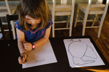 Girl drawing picture of a rabbit