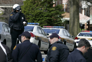 Police officers wait for the end of a standoff with a man in Pittsburgh
