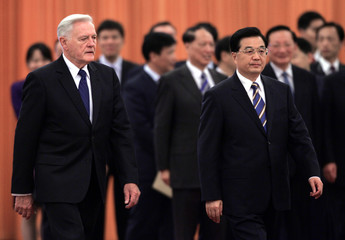 China's President Hu Jintao and Lithuania's President Valdas Adamkus attend a welcome ceremony in Beijing