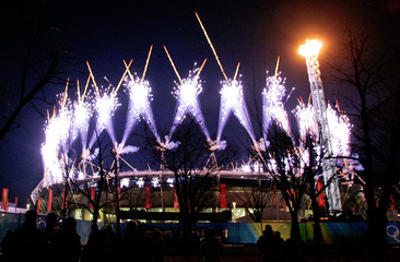Fireworks explode over Olympic Stadium after lighting of Olympic flame for Torino 2006 Winter Olympic Games in Turin