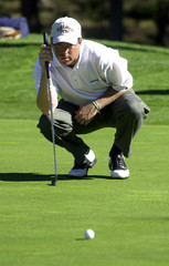 OLIN BROWNE LINES UP PUTT AT THE PEBBLE BEACH PRO-AM.