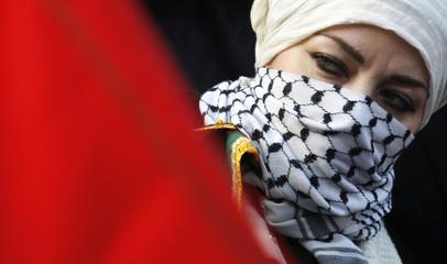Demonstrator wears Palestinian kaffiyeh as she takes part in demonstration, against Israeli attacks in Gaza Strip, in Strasbourg