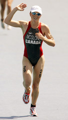 Canada's Samantha McGlone finishes the women's triathlon.