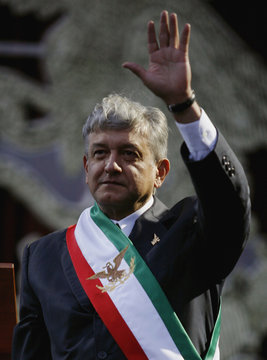 """Andres Manuel Lopez Obrador waves after he was sworn in as """"legitimate president""""  at Mexico City's Zocalo square"""