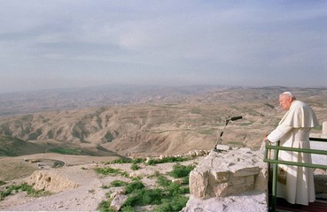POPE JOHN PAUL II STANDS ON TOP OF MOUNT NEBO.