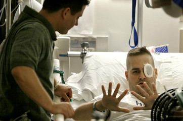 INJURED TROOPS ARE TREATED AT WALTER REED ARMY MEDICAL CENTER.