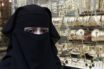 A SAUDI TOURIST SHOPS FOR GOLD JEWELLERY IN DAMASCUS.