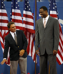 Former NFL star Doug Flutie and former NBA great David Robinson attend the opening ceremony at the U.S. Open tennis tournament in New York