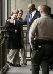 Producer Phil Spector arrives with wife Rachelle Short at Los Angeles courthouse to begin his murder trial