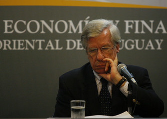Uruguay's Economy Minister Astori gestures during a news conference in Montevideo