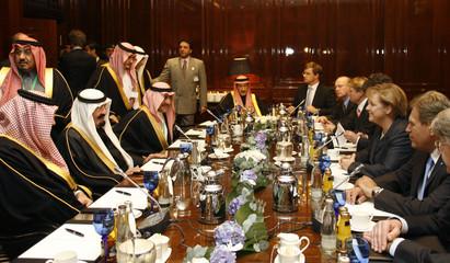 German Chancellor Angela Merkel  talks to Saudi Arabia's King Abdullah during a reception in Berlin