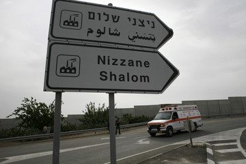 An ambulance is seen at the Nitzanei Shalom industrial zone, near the West Bank town of Tulkarm