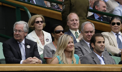 Former Wimbledon Champion, Sampras, and the Governor of the Bank of England, King, sit on Centre Court to watch the Gentlemen's Singles finals match between Roddick and Federer at the Wimbledon tennis championships in London